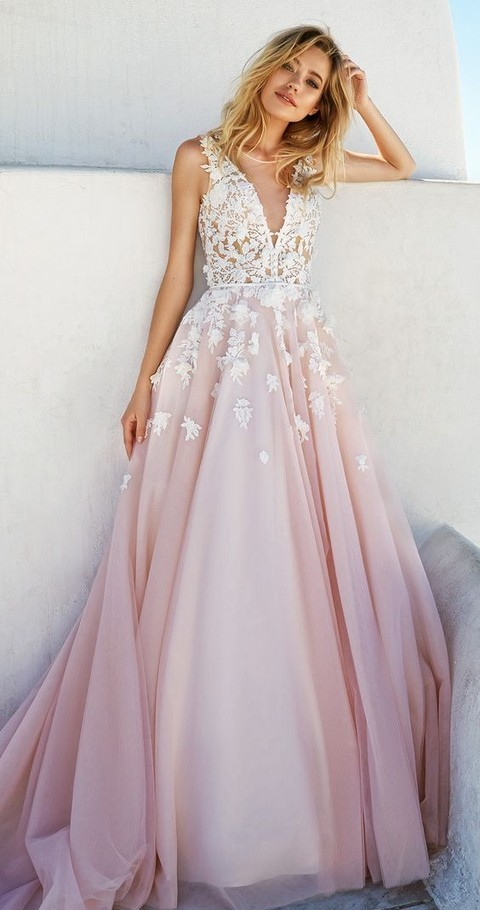 a floral applique wedding dress with a plunging neckline and a pink skirt