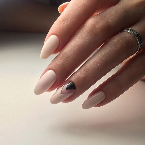 ivory nails and an accent chevron one with negative space and black