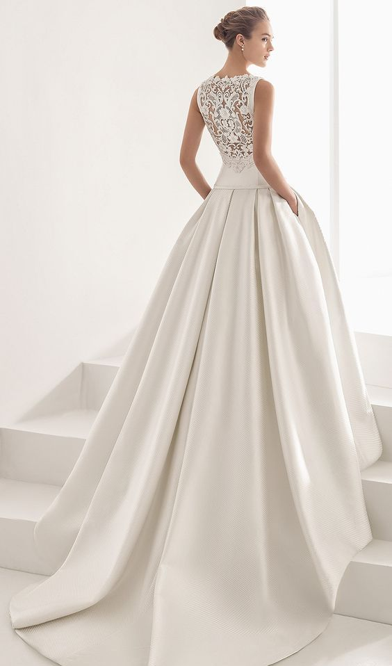 ballgown with a lace back and a plain skirt with a train and pockets