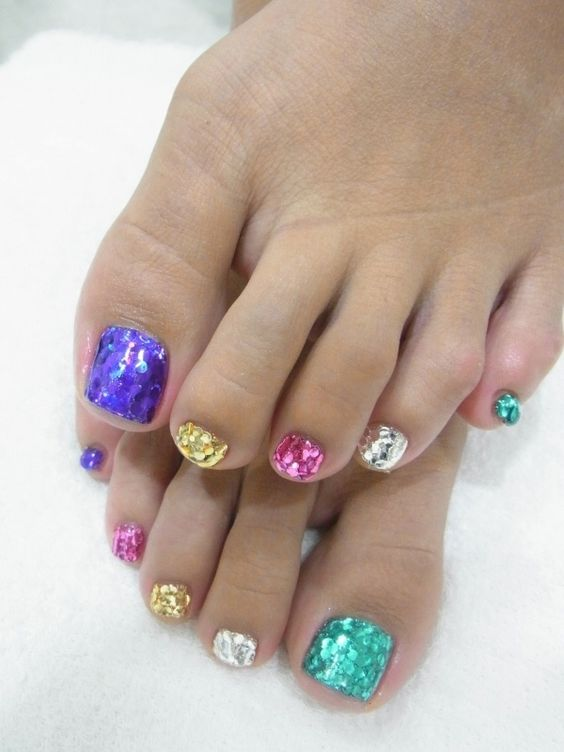 sequin toe nails, each of a different color to sparkle