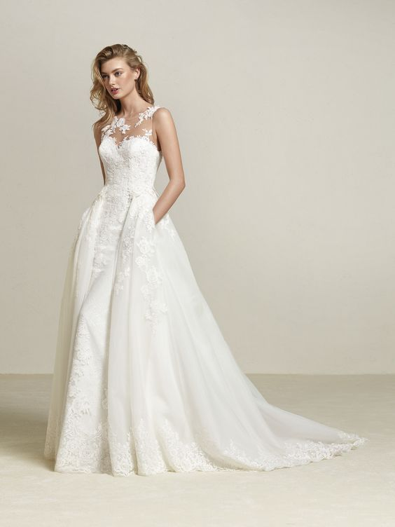 illusion strapless neckline wedding dress with lace appliques, a detachable overskirt with pockets