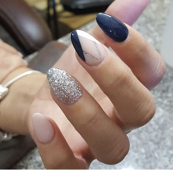navy and blush nails with one silver glitter nail and one navy blush geo nail