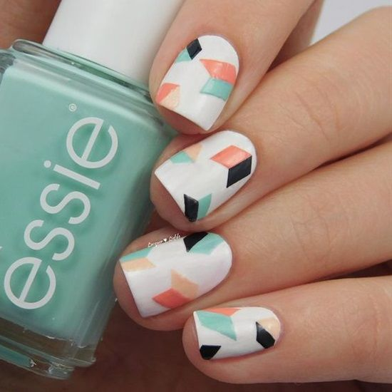 geometric nails in white, black, mint and orange with a chaotic geo design