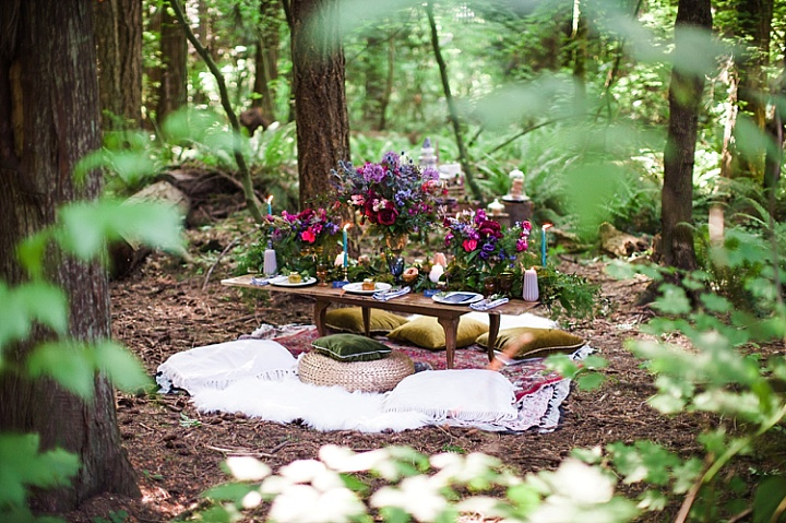 There was a low table laid right in the woods, with blankets and pillows around for a boho picnic