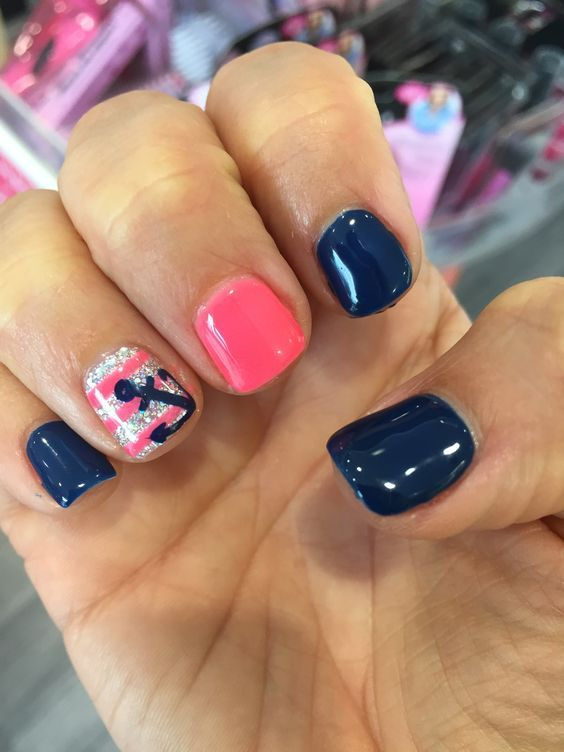 royal blue nails, a pink one and a striped glitter one with an anchor