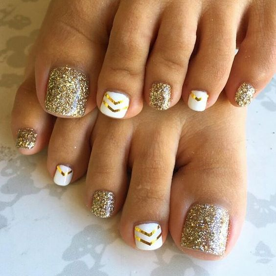 gold glitter nails and white ones with gold chevron