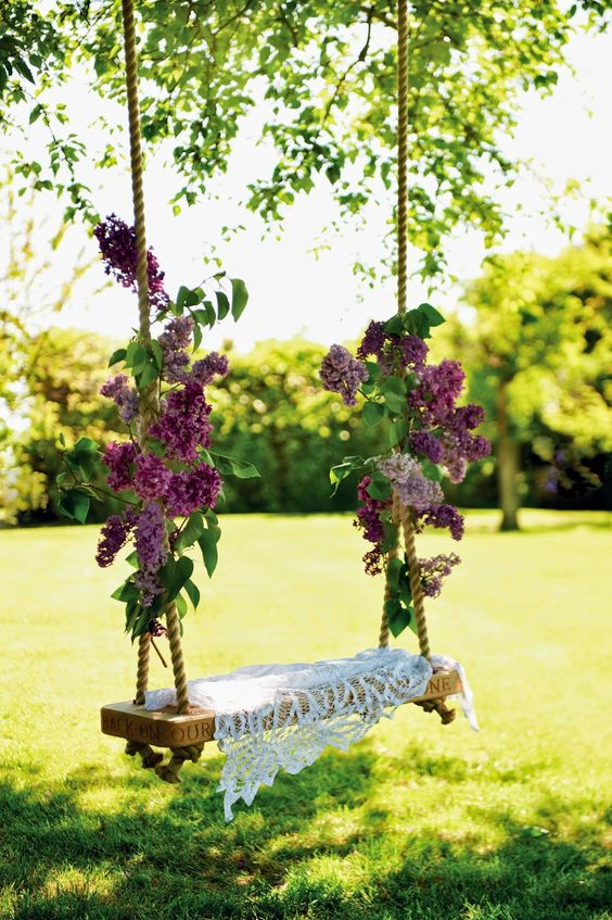 lilac branches tied to a garden swing and a dily will make it sweet