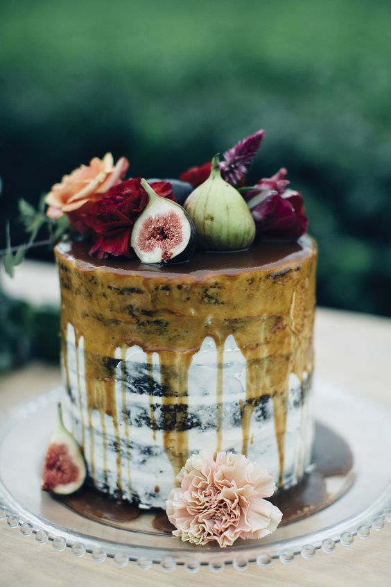 semi naked wedding cake with caramel drip, fresh blooms and figs