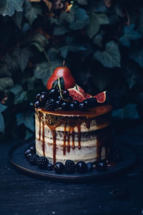 semi naked wedding cake with salted caramel drip, fresh figs, grapes and blackberries