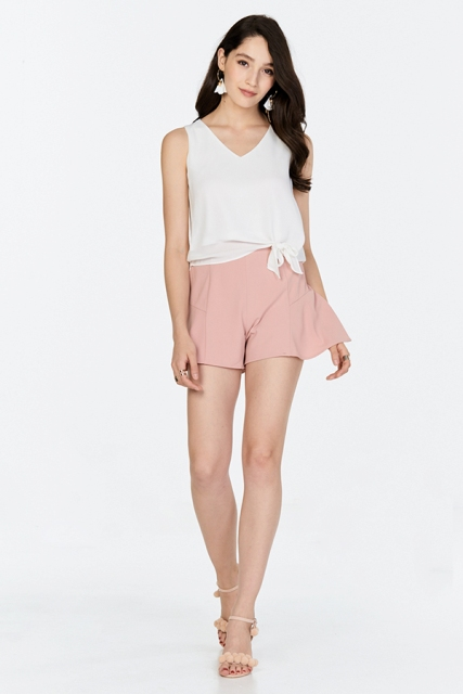 With white top and pale pink sandals