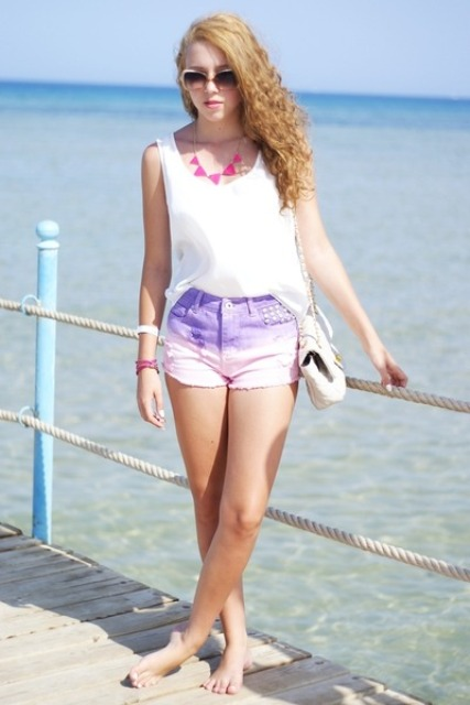 With white top, white bag and pink necklace