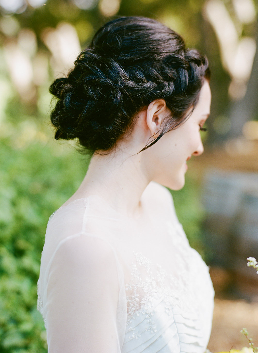 braided wedding hair - photo by Taken by Sarah Photography http://ruffledblog.com/intimate-rustic-chic-wedding-inspiration
