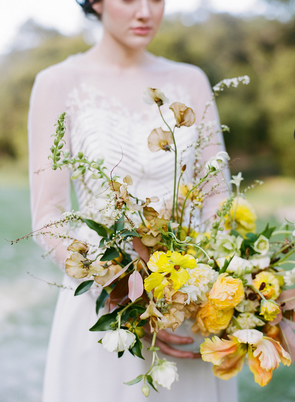 yellow garden bouquets - photo by Taken by Sarah Photography http://ruffledblog.com/intimate-rustic-chic-wedding-inspiration
