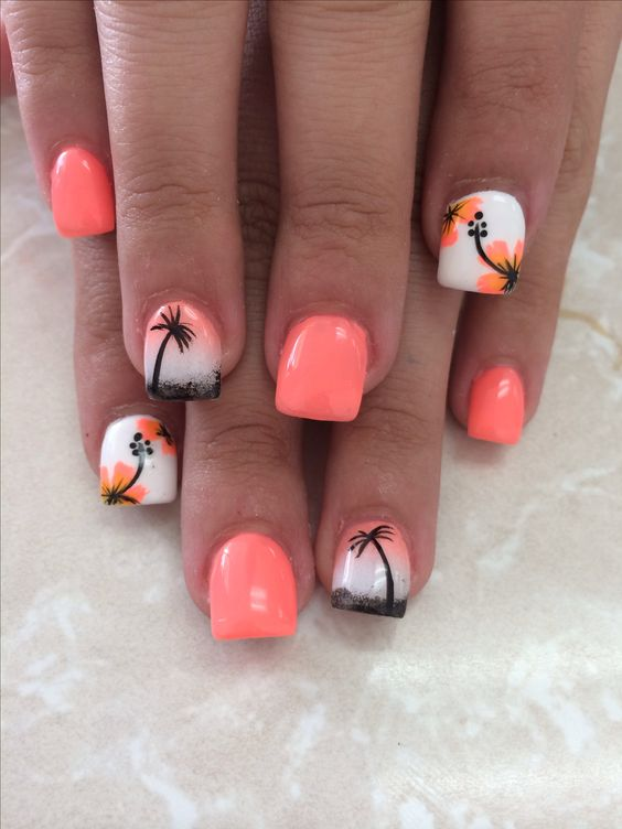 orange nails and accent ones with palm trees and tropical flowers