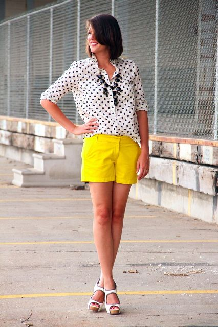 With polka dot blouse, white shoes and black necklace