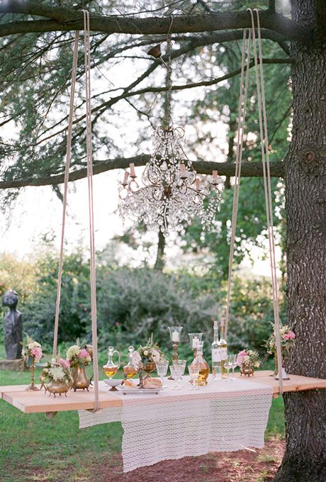 a swing turned into a hanging bar for an outdoor wedding