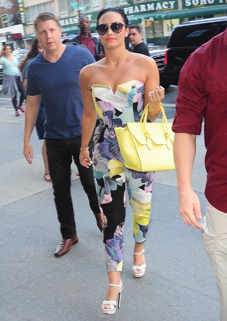 With yellow bag and white platform sandals