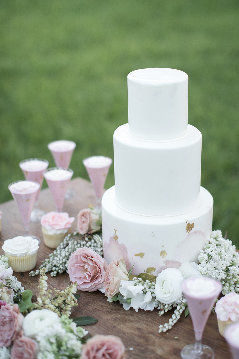 white wedding cakes - photo by Tyler Rye Photography http://ruffledblog.com/romantic-coastal-california-wedding-inspiration