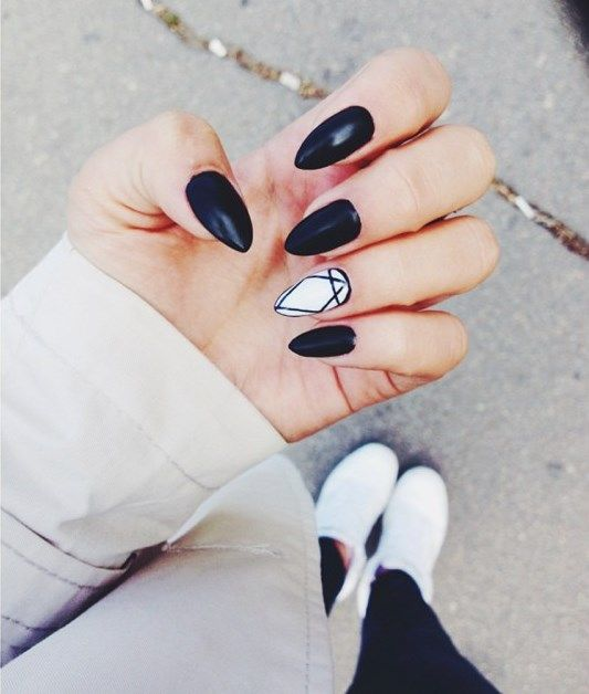 black nails and an accent white geo accent nail