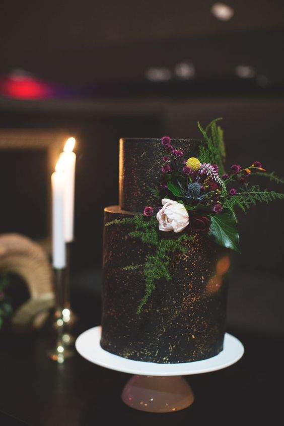dark chocolate cake with copper detailing and fresh flowers