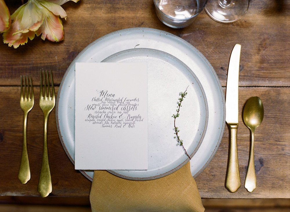 place settings - photo by Taken by Sarah Photography http://ruffledblog.com/intimate-rustic-chic-wedding-inspiration