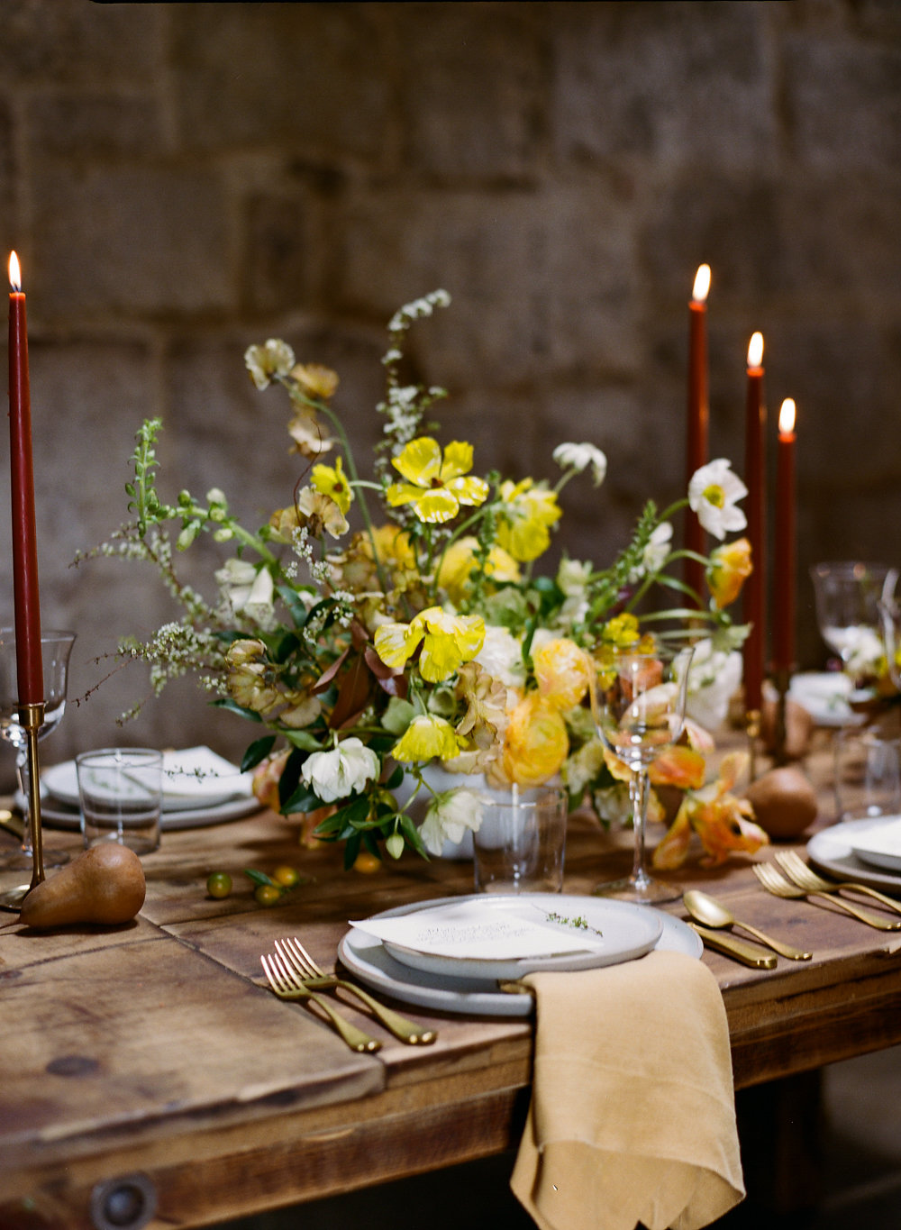 yellow centerpieces - photo by Taken by Sarah Photography http://ruffledblog.com/intimate-rustic-chic-wedding-inspiration