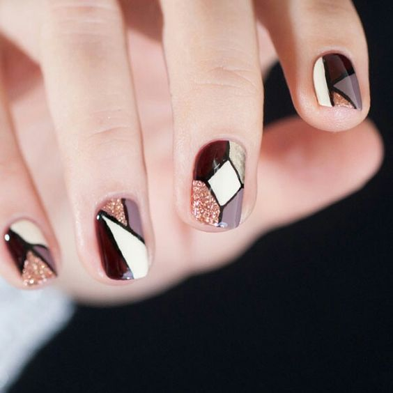 mauve, cream, burgundy, glitter and gold geo nails, each nail is different