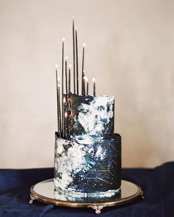 unique constellation wedding cake in navy and black with thin black candles