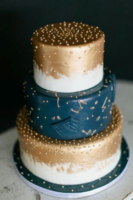 navy, copper and white wedding cake with constellation detailing