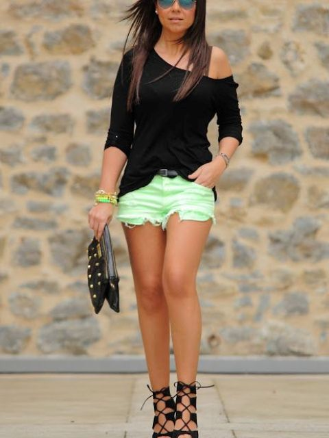 With black shirt, lace up sandals and black clutch