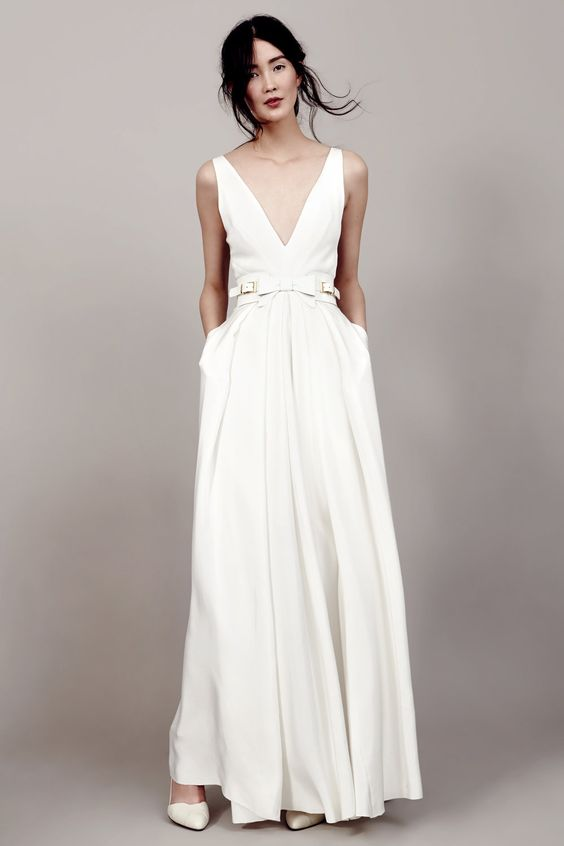 modern plain wedding gown with a V neckline, pockets and a white leather belt