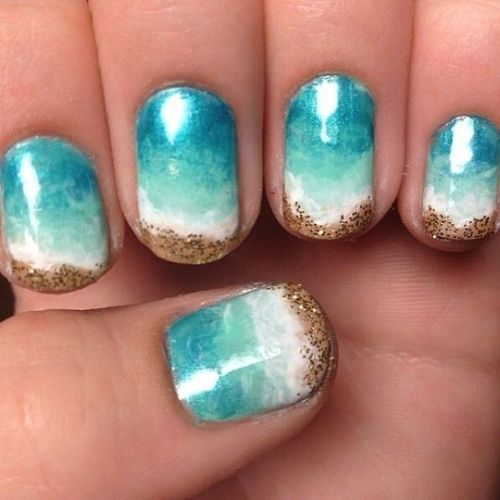 ombre turquoise nails from blue to white and sand-inspired glitter decor
