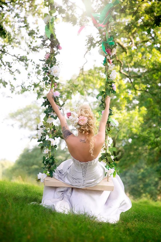 heavenly beautiful swing with pink and blush flowers and leaves