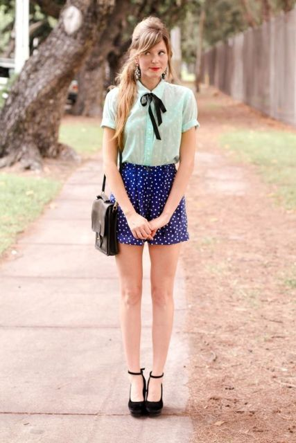 With mint blouse, black mini bag and platform shoes