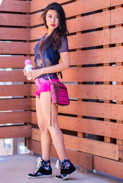 With colorful t-shirt, hot pink bag and sneakers
