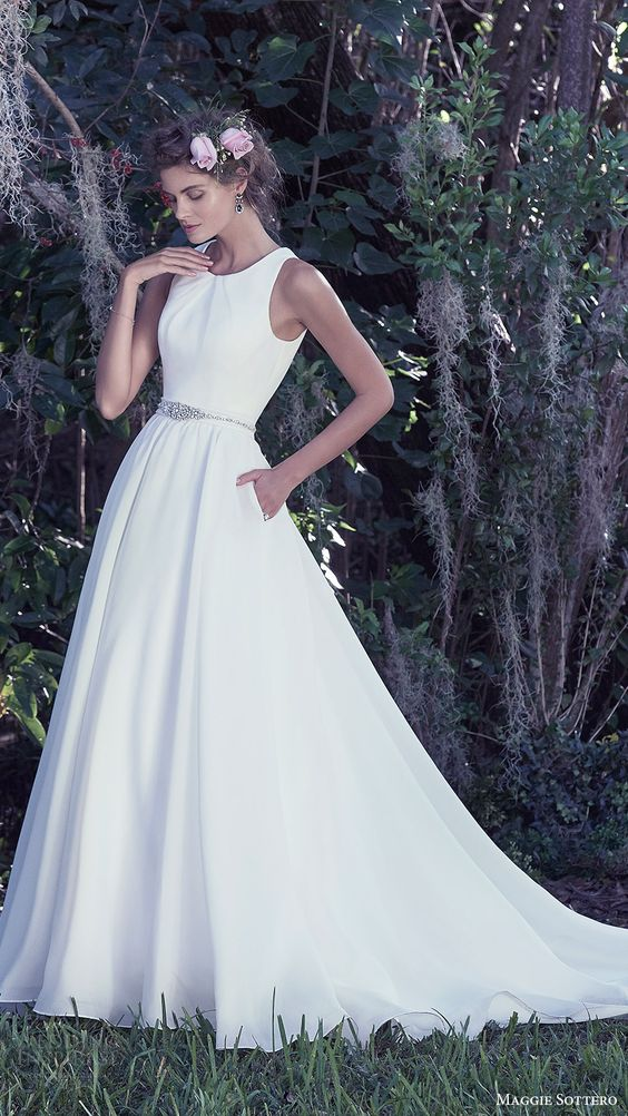 modern plain white scoop neckline A-line wedding gown with an embellished sash and pockets