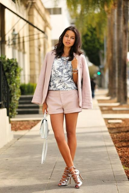 With printed top, light pink blazer, white mini bag and metallic heels