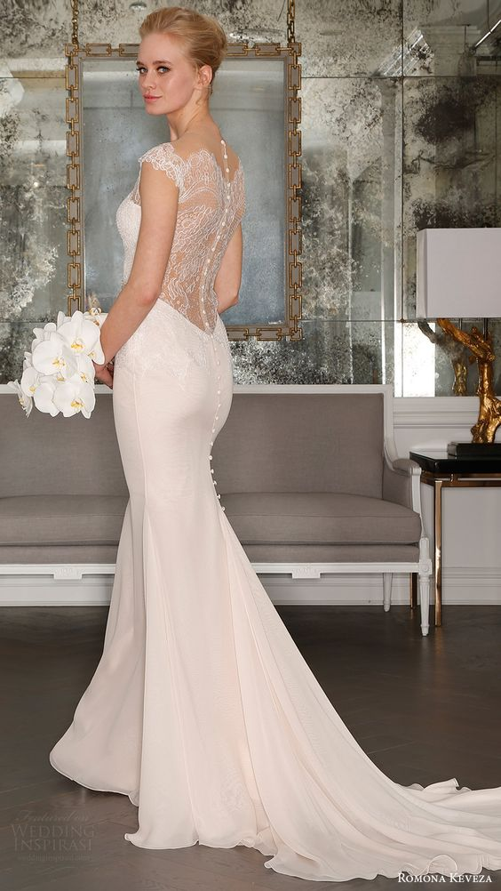 blush mermaid wedding dress with an illusion back and sheer lace cap sleeves