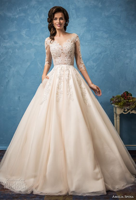 champagne-colored wedding dress with an illusion lace bodice with sleeves and lace appliques