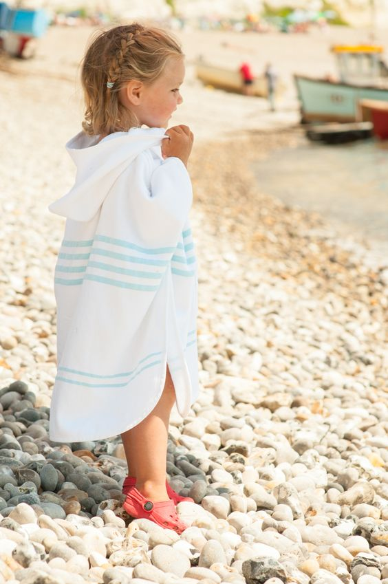 striped hooden beach poncho can double as a towel, you don't need to carry much