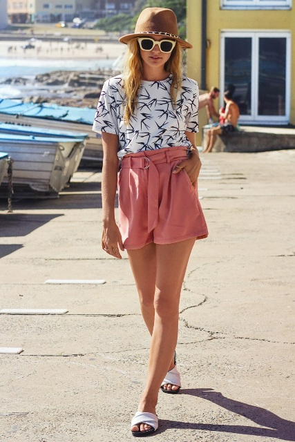 With printed shirt, white slide sandals and hat