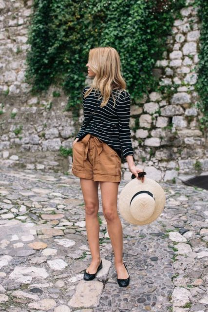 With striped loose shirt, black flats and wide brim hat