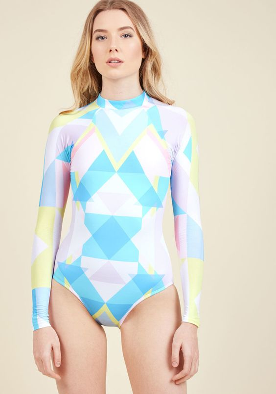 bold neon geo print long sleeve swimsuit for surfing