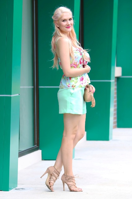 With floral top, beige heels and mini bag