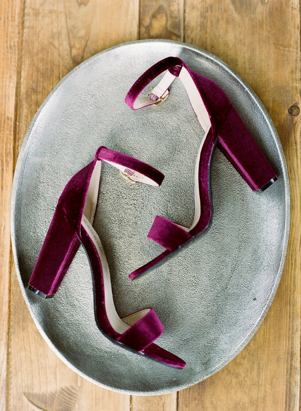 burgundy wedding shoes - photo by Taken by Sarah Photography http://ruffledblog.com/intimate-rustic-chic-wedding-inspiration
