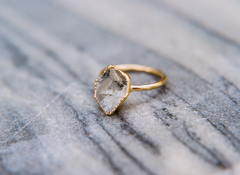 unique engagement rings - photo by Taken by Sarah Photography http://ruffledblog.com/intimate-rustic-chic-wedding-inspiration