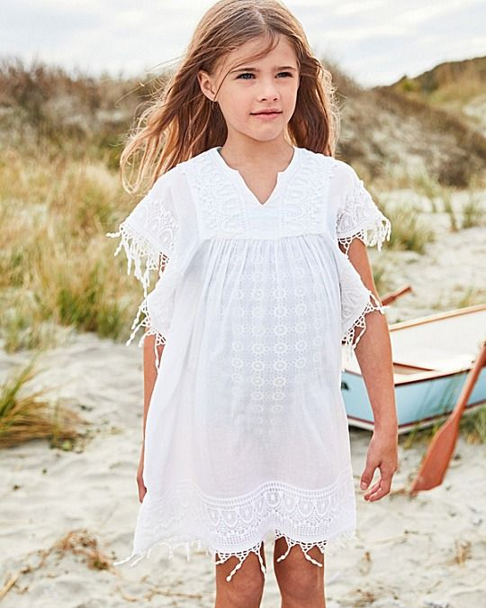a cotton cover-up with fringe that can also double as a lightweight everyday layer