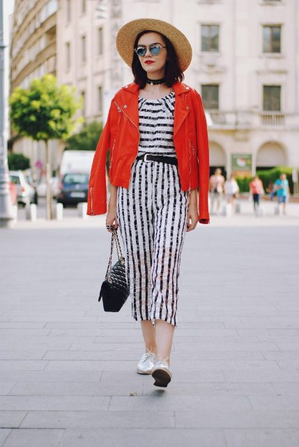 With wide brim hat, red jacket, white shoes and chain strap bag
