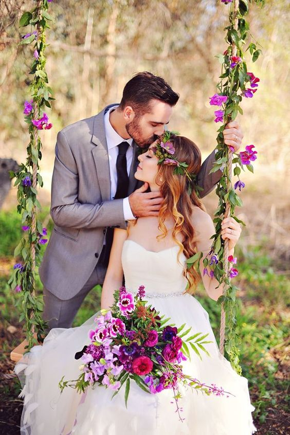 a bold swing with greenery and purple blooms