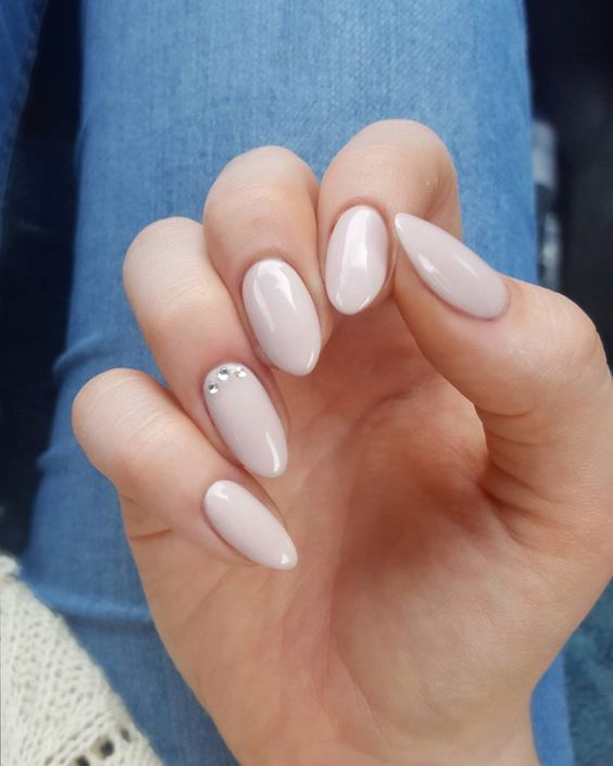 nude nails with an accent rhinestone one